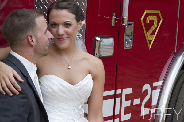 bride and groom by firetruck