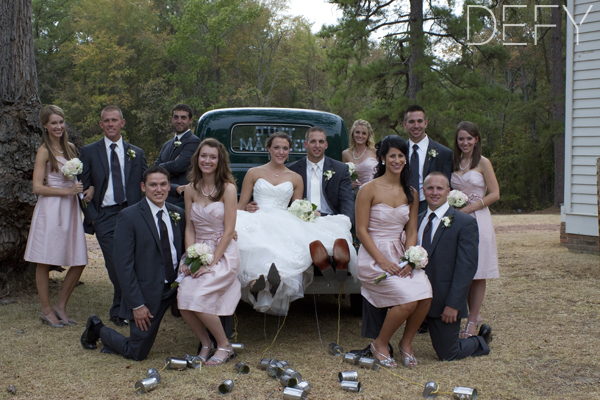entire bridal party around truck
