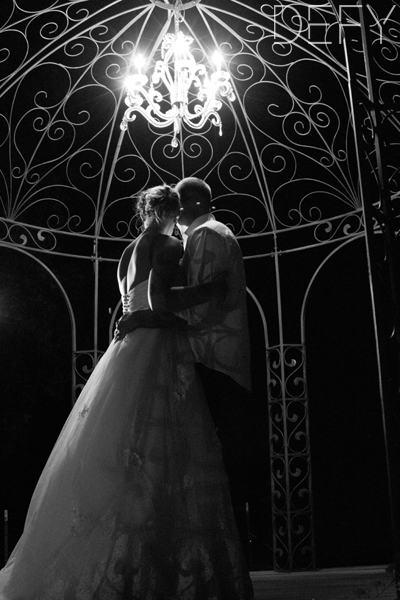 bride and groom under the gazebo
