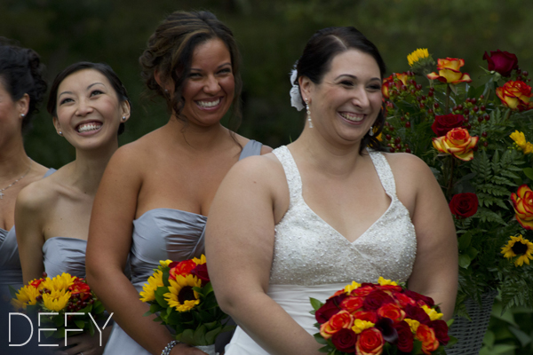 Bride and bridesmaids giggling