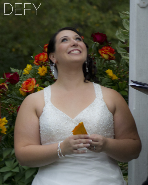 Bride releasing butterfly