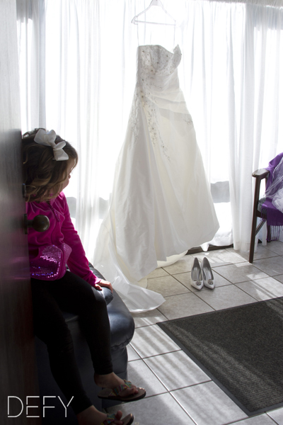 Flower girl with brides dress