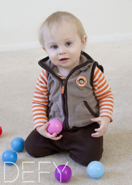 1 year old with toy balls