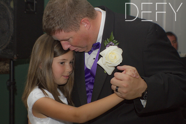 groom dances with daughter