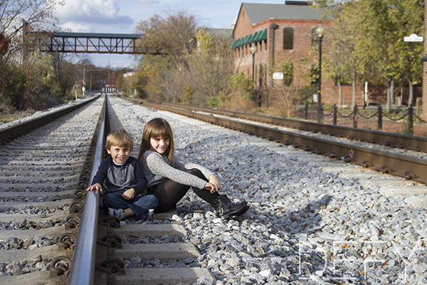 siblings on train tracks