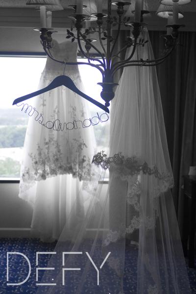 wedding dress and veil hanging