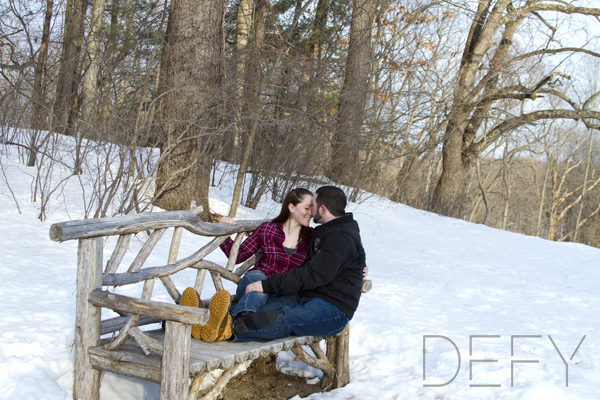 kissing on a wooden bench